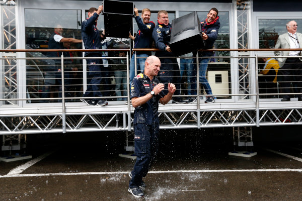 Spa-Francorchamps, Spa, Belgium. Saturday 23 August 2014. Adrian Newey, Chief Technical Officer, Red Bull Racing, receives a soaking from Sebastian Vettel, Red Bull Racing, and Daniel Ricciardo, Red Bull Racing, after being nominated for the Ice Bucket Challenge. World Copyright: Alastair Staley/LAT Photographic. ref: Digital Image _R6T4872