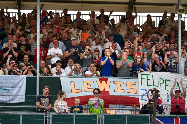 Silverstone, Northamptonshire, England. Thursday 3 July 2014. Fans show support for Lewis Hamilton, Mercedes AMG, and Felipe Massa, Williams F1. World Copyright: Steve Etherington/LAT Photographic. ref: Digital Image SNE20017