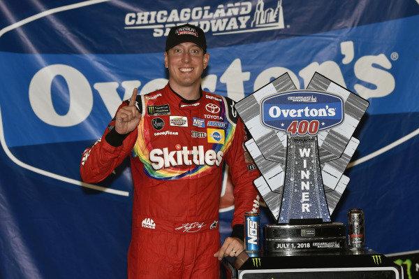 #18: Kyle Busch, Joe Gibbs Racing, Toyota Camry Skittles Red White & Blue celebrates his win