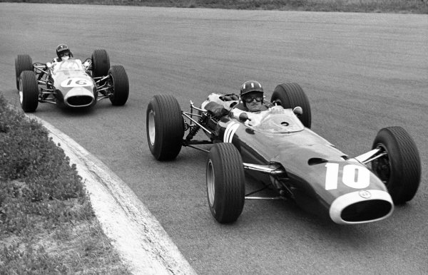 1965 Dutch Grand Prix.Zandvoort, Holland. 18 July 1965.Graham Hill, BRM P261, 4th position, leads Dan Gurney, Brabham BT11-Climax, 3rd position, action.World Copyright: LAT Photographic.ref: Motor b/w print.