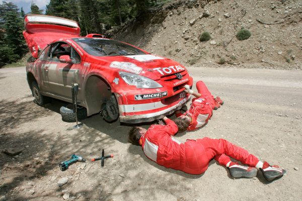 2004 FIA World Rally Champs. Round seven, Rally Turkey.24th- 27th June 2004.Marcus Gronholm,Peugeot, repairing car.World Copyright: McKlein/LAT