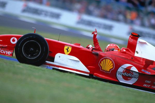2004 British Grand Prix Silverstone England. 9th - 11th July. Michael Schumacher, Ferrari F2004 celebrates his 80th Grand Prix Vivtory.  World Copyright:Glenn Dunbar/LAT Photographic Ref:35mm image A21