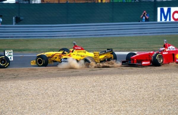 Giancarlo Fisichella (ITA) Jordan hits teamate Ralf Schumacher (GER) Jordan who hits his brother Michael Schumacher (GER) Ferrari Formula One World Championship, Luxembourg Grand Prix, Rd 15, Nurburgring, Germany, 28th September 1997