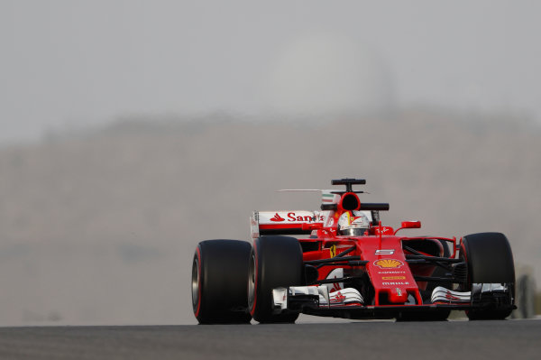 Bahrain International Circuit, Sakhir, Bahrain.  Wednesday 19 April 2017. Sebastian Vettel, Ferrari SF70H.  World Copyright: Glenn Dunbar/LAT Images ref: Digital Image _X4I4628