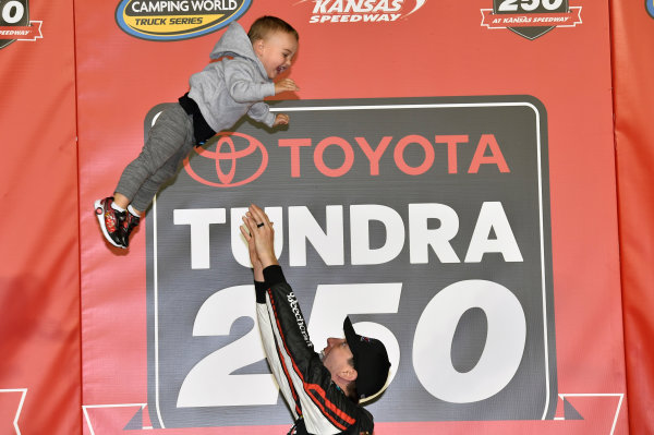 NASCAR Camping World Truck Series Toyota Tundra 250 Kansas Speedway, Kansas City, KS USA Friday 12 May 2017 Kyle Busch, Cessna Toyota Tundra celebrates his win in Victory Lane World Copyright: Nigel Kinrade LAT Images ref: Digital Image 17KAN1nk07220