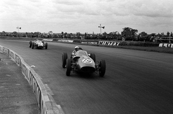 Maurice Trintignant, Aston Martin DBR5/250, leads Jim Clark, Lotus 18 Climax.