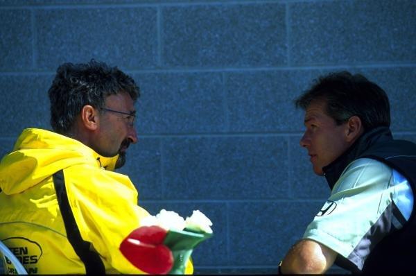 Eddie Jordan (L) and Craig Pollock (R) have a conversation. USA Grand Prix, Indianapolis, USA, 30 September 2001