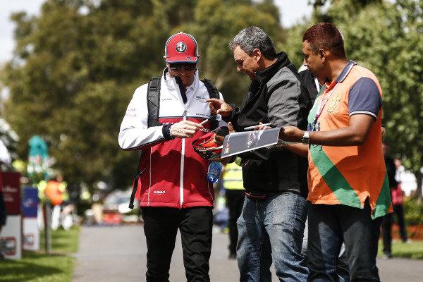 Kimi Raikkonen, Alfa Romeo Racing, signs an autograph for fans