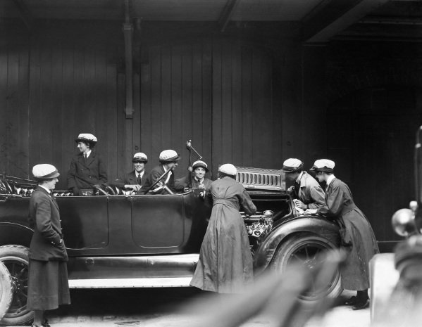 Members of the Women's Royal Naval Service work on the engine of a Cadillac during their driver training at the WRNS Garage in Charing Cross.