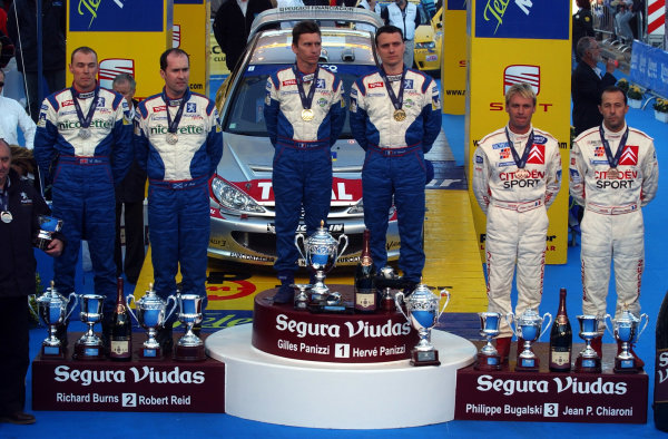 """2002 World Rally ChampionshipRally Catalunya, 21st-24th March 2002.""""Olympic Podium"""" for the top 3 places on the event - 1st, Gilles Panizzi; 2nd, Richard Burns; 3rd, Philippe Bugalski.Photo: Ralph Hardwick/LAT"""