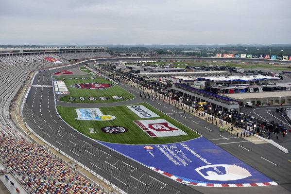 A general view of drivers and crew standing on pit road during the national anthem, Copyright: Jared C. Tilton/Getty Images.