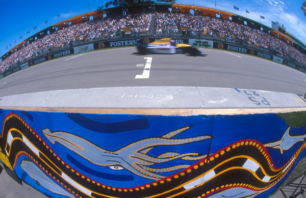 1993 Australian Grand Prix.Adelaide, Australia.5-7 November 1993.Damon Hill (Williams FW15C Renault) 3rd position zooms by the packed grandstands and the Aboriginal art on the pit wall.Ref-93 AUS 35.World Copyright - LAT Photographic