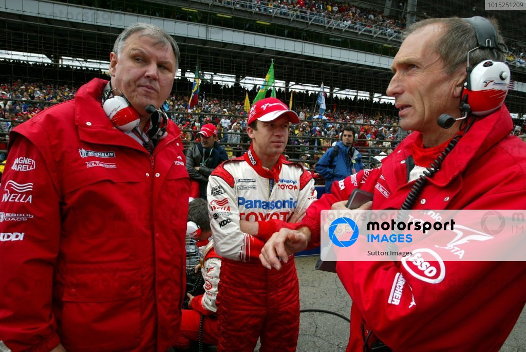 (L to R): Norbert Kreyer (GER) Senior General Manager of Race and Test Engineering, Olivier Panis (FRA) Toyota and Humphrey Corbett (GBR) Toyota Race Engineer on the grid.Formula One World Championship, Rd15, United States Grand Prix, Race Day, Indianapolis, USA, 28 September 2003.DIGITAL IMAGE