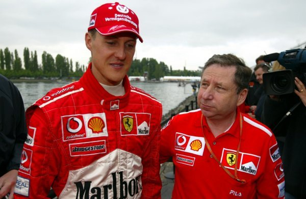 (L to R): Michael Schumacher (GER) Ferrari with Jean Todt (FRA) Ferrari General Manager.Formula One World Championship, Rd8, Canadian Grand Prix, Montreal, Canada, 14 June 2003.DIGITAL IMAGE