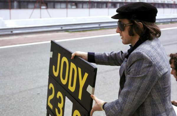 Retired World Champion Jackie Stewart (GBR) holds the pit board for fifth placed Jody Scheckter (RSA) Tyrrell.Spanish Grand Prix, Jarama, 28 April 1974.BEST IMAGE