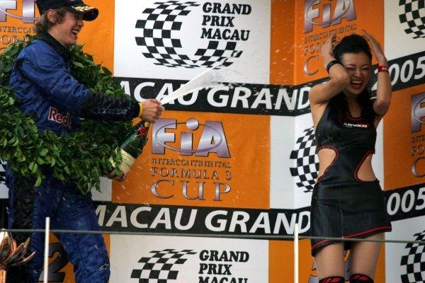 Sebastian Vettel (GER) ASM F3 sprays a Yokohama girl with champange. 52nd Macau Grand Prix, Race Day, Guia Circuit, Macau, China, 17-20 November 2005. DIGITAL IMAGE