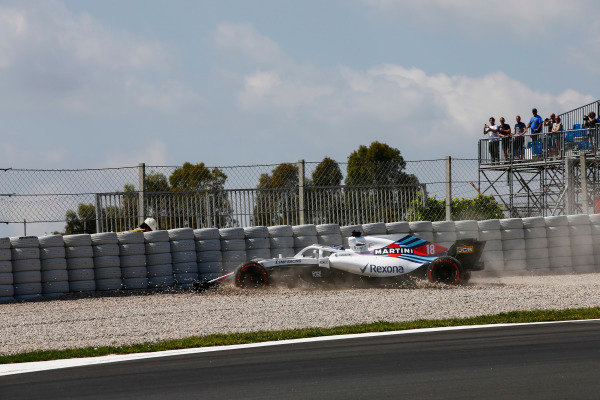 Lance Stroll, Williams FW41 Mercedes, drives into the gravel in FP1.