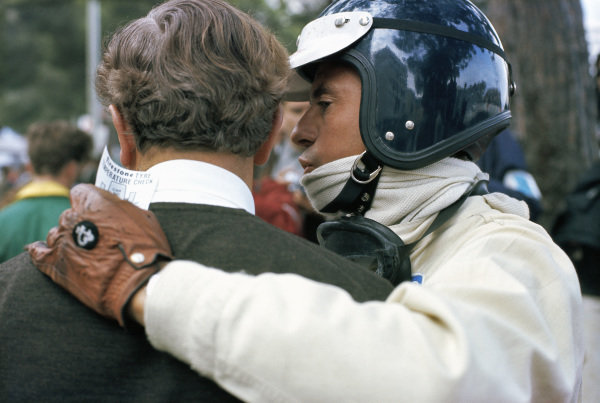 Jim Clark with Colin Chapman during practice.