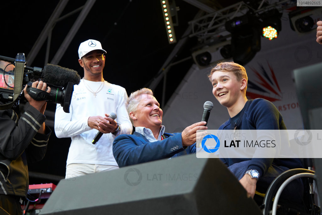 Silverstone, Northamptonshire, UK.  Saturday 15 July 2017. Lewis Hamilton, Mercedes AMG, and Johnny Herbert on stage with injured British Formula 4 racer Billy Monger. World Copyright: Steve Etherington/LAT Images  ref: Digital Image SNE12348