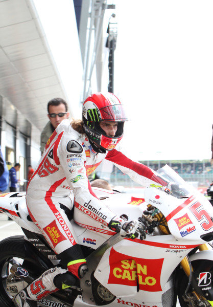 British Grand Prix. Silverstone, England. 10th-12th June 2011. Marco Simoncelli, Honda, leaves the pits. Action, portrait. World Copyright: Kevin Wood/LAT Photographic. ref: Digital Image
