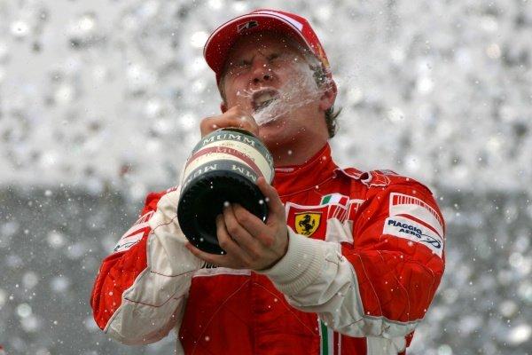 Kimi Raikkonen (FIN) Ferrari celebrates on the podium Formula One World Championship, Rd17, Brazilian Grand Prix, Race Day, Interlagos, Sao Paulo, Brazil, Sunday 21 October 2007.  BEST IMAGE