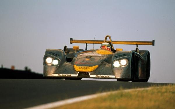 Allan McNish (GBR) Audi R8 peers through the early morning sunlight en route to a second place finish. Le Mans 24 Hours, le Sarthe, France, 17-18 June 2000.