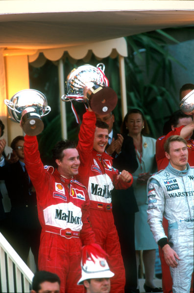 1999 Monaco Grand Prix Monte Carlo, Monaco.  13-16 May 1999. Michael Schumacher (Ferrari) 1st position, Eddie Irvine (Ferrari) 2nd position and Mika Hakkinen (McLaren Mercedes) 3rd position on the podium. Ref-99 MON 25. World Copyright - Steven Tee/LAT Photographic.