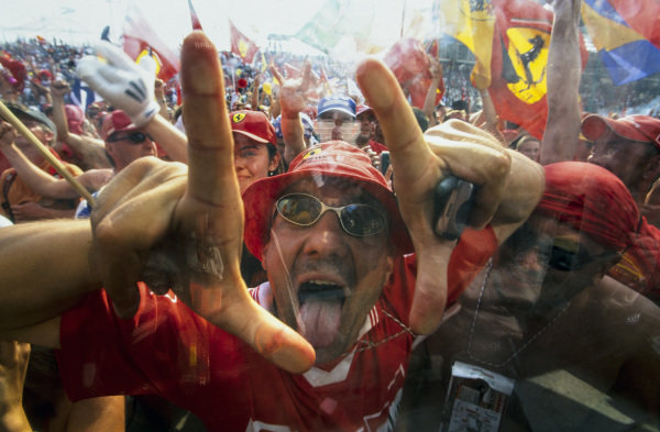 Ferrari fans celebrate a 1-2 finish.
