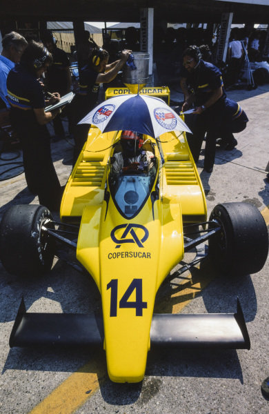 Emerson Fittipaldi waits in his Fittipaldi F6A Ford. Designer Richard Divila stands next to the car.