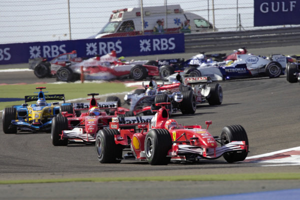 Michael Schumacher, Ferrari 248 F1 leads Felipe Massa, Ferrari 248 F1 and Fernando Alonso, Renault R26 while Nick Heidfeld, BMW Sauber F1.06 is spun around in the background.