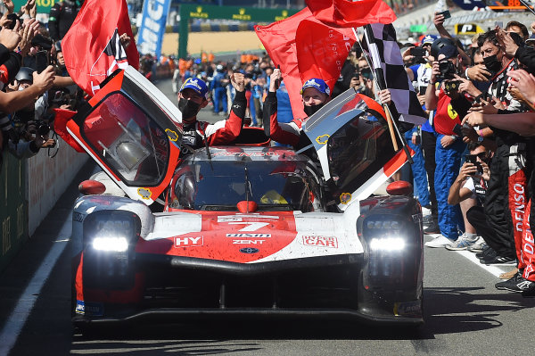 Mike Conway, Kamui Kobayashi, Jose Maria Lopez, #7 Toyota Gazoo Racing Toyota GR010 - Hybrid Hypercar celebrate victory.