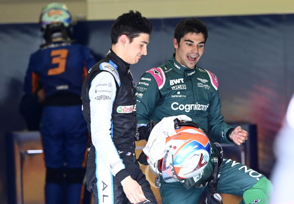 Esteban Ocon, Alpine F1, and Lance Stroll, Aston Martin, talk after the race