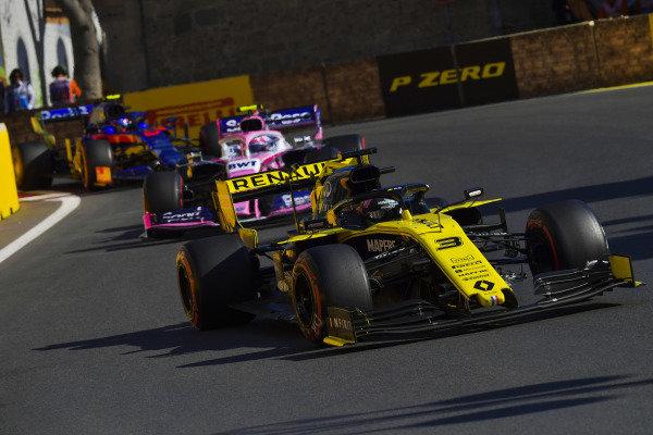 Daniel Ricciardo, Renault R.S.19, leads Lance Stroll, Racing Point RP19, and Alexander Albon, Toro Rosso STR14