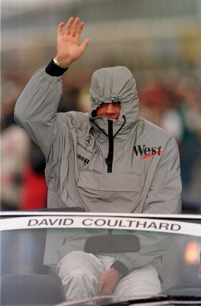 1998 Canadian Grand Prix.Montreal, Quebec, Canada. 5-7 June 1998.David Coulthard (McLaren Mercedes-Benz) shelters from the cold as he waves to the fans on the drivers parade lap.World Copyright - Steve Etherington/LAT Photographic