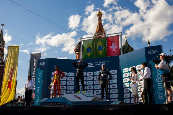 2014/2015 FIA Formula E Championship. Moscow ePrix, Moscow, Russia. Saturday 6 June 2015 Podium. 1st, Nelson Piquet Jr (BRA)/China Racing - Spark-Renault SRT_01E, 2nd, Lucas di Grassi (BRA)/Audi Abt Sport - Spark-Renault SRT_01E and 3rd Sebastien Buemi (SWI)/E.dams Renault - Spark-Renault SRT_01E. Photo: Zak Mauger/LAT/Formula E ref: Digital Image _MG_8463