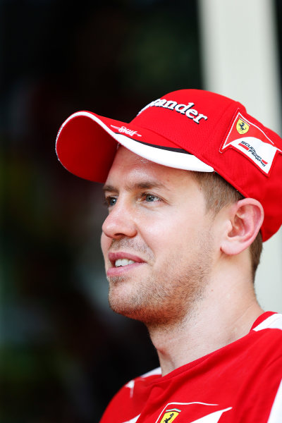 Sepang International Circuit, Sepang, Kuala Lumpur, Malaysia. Thursday 26 March 2015. Sebastian Vettel, Ferrari. World Copyright: Charles Coates/LAT Photographic. ref: Digital Image _N7T2416