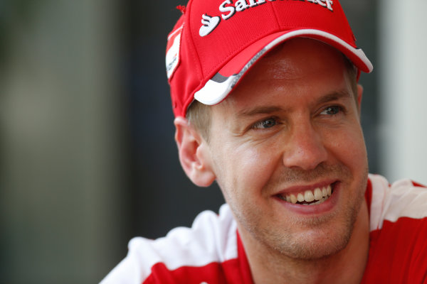 Sepang International Circuit, Sepang, Kuala Lumpur, Malaysia. Thursday 26 March 2015. Sebastian Vettel, Ferrari, in the Paddock. World Copyright: Alastair Staley/LAT Photographic. ref: Digital Image _79P0582