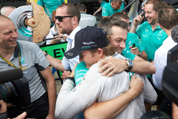 Red Bull Ring, Spielberg, Austria. Sunday 22 June 2014. Nico Rosberg, Mercedes AMG, 1st Position, celebrates with his team after the race. World Copyright: Steve Etherington/LAT Photographic. ref: Digital Image SNE26794copy