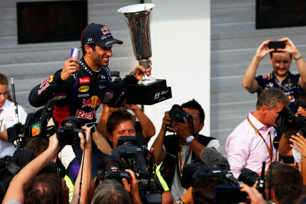 Hungaroring, Budapest, Hungary. Sunday 27 July 2014. Daniel Ricciardo, Red Bull Racing, 1st Position, and the Red Bull team celebrate victory. World Copyright: Andy Hone/LAT Photographic. ref: Digital Image _ONY2962