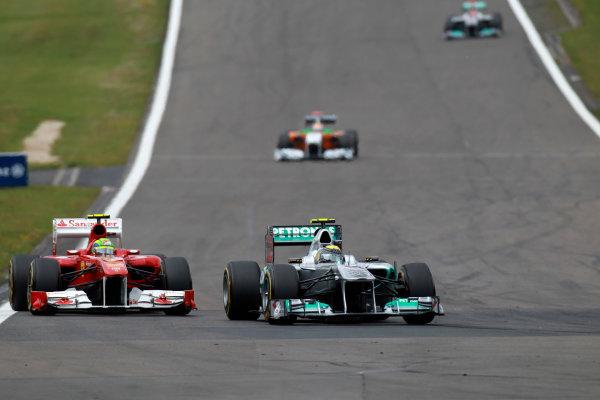 Nurburgring, Germany24th July 2011Nico Rosberg, Mercedes GP W02, 7th position, leads Felipe Massa, Ferrari 150° Italia, 5th position. Action. World Copyright:Glenn Dunbar/LAT Photographicref: Digital Image C27C4584