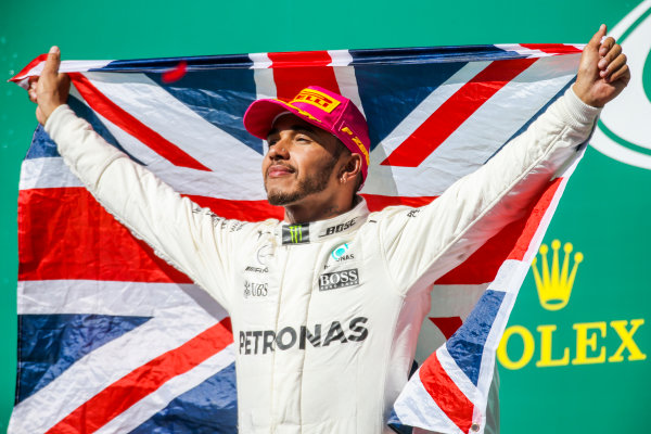 Circuit of the Americas, Austin, Texas, United States of America. Sunday 22 October 2017. Lewis Hamilton, Mercedes AMG, 1st Position, with a Union flag on the podium. World Copyright: Charles Coates/LAT Images  ref: Digital Image DJ5R5811