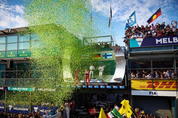 Albert Park, Melbourne, Australia. Sunday 26 March 2017. Confetti showers the top three drivers on the podium. World Copyright: Steve Etherington/LAT Images ref: Digital Image SNE15878