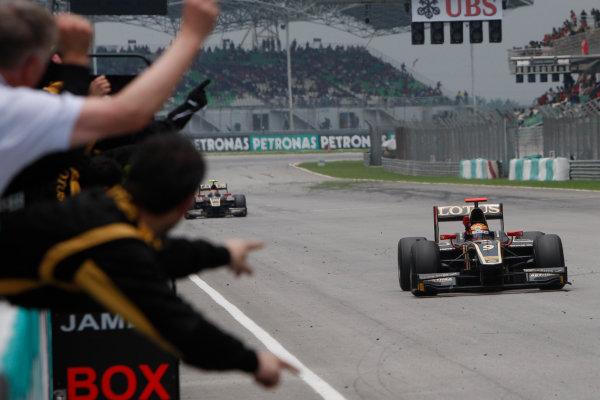 Sepang, Kuala Lumpur, Malaysia. 25th March 2012. Sunday Race.James Calado (GBR, Lotus GP) crosses the line to take victory. Action.World Copyright: Alastair Staley/GP2 Series Media Service.Ref: Digital Image _O9T2623.jpg