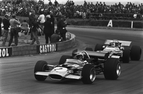 Silverstone, Great Britain. 19 July 1969.Jochen Rindt, Lotus 49B-Ford, 4th position, leads Jackie Stewart, Matra MS80-Ford, 1st position, action.World Copyright: LAT PhotographicRef: 1076B #23A
