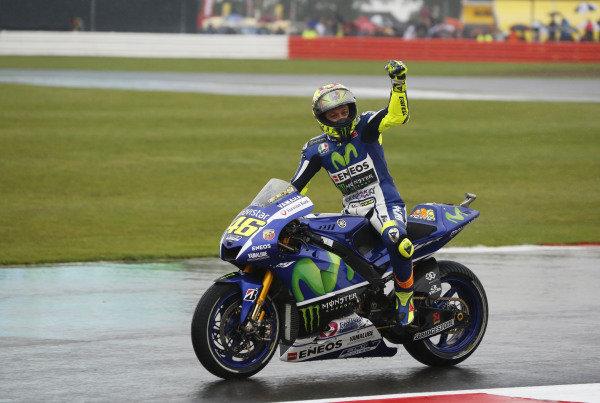 2015 MotoGP Championship.  British Grand Prix.  Silverstone, England. 28th - 30th August 2015.  Valentino Rossi, Yamaha, celebrates victory.  Ref: KW5_5517a. World copyright: Kevin Wood/LAT Photographic