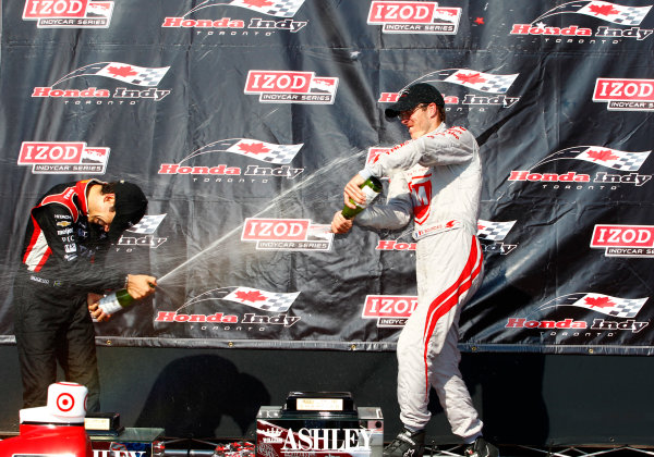 14 July, 2013,  Toronto, Ontario, CAN Helio Castroneves and Sebastien Bourdais celebrate with champagne on the podium ©2013, Phillip Abbott LAT Photo USA
