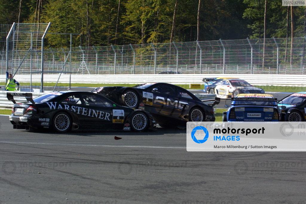 Jean Alesi (FRA), AMG-Mercedes CLK,  lands on top of Marcel Fassler (CZH), Warsteiner AMG-Mercedes CLK,  after driving into Alain Menu (FRA), Opel Euroteam Astra Coupe, at the new hairpin corner.DTM Championship, Rd10, Hockenheim, Germany. 06 October 2002.DIGITAL IMAGE