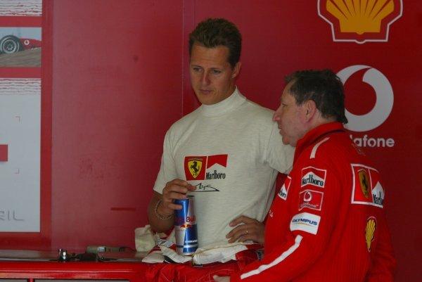 (L to R): Michael Schumacher (GER) Ferrari with Jean Todt (FRA) Ferrari General Manager.Formula One World Championship, Rd4, San Marino Grand Prix, Imola, Italy, 18 April 2003.DIGITAL IMAGE