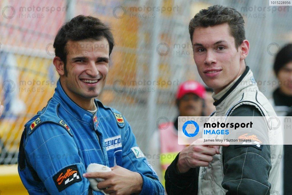 (L to R):  Vitantonio Liuzzi (ITA) Team Kolles and Alan Van Der Merwe (RSA) Carlin Motorsport  show off their favourite sponsor. Macau Formula Three Grand Prix. 13 - 17 November 2002, Macau Guia Circuit, Macau, China. DIGITAL IMAGE.