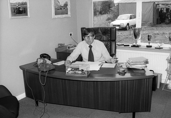 Team owner Ken Tyrrell (GBR) in his office at the Tyrrell factory.